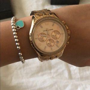 Michael Kors rose gold oversized watch.